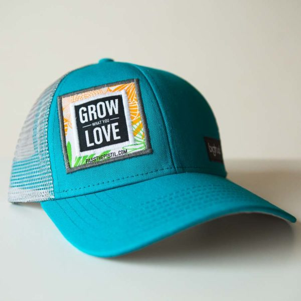 """a Jade colored hat with """"grow what you love"""" embroidered on the face"""