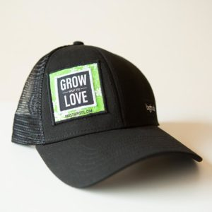 "a black hat with ""grow what you love"" embroidered on the face"
